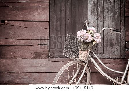 Bicycles Old Vintage Flowers In A Basket. Parked On The Sidewall Of The Wooden House Ideal For Desig