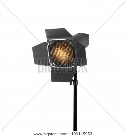 Studio flash isolated on a white background. Photo studio lighting equipment. Modern powerful photographic flash. Professional photographic equipment. Studio video light on a long tripod.