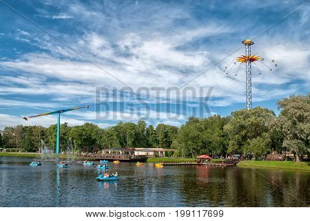 SAINT - PETERSBURG, RUSSIA - AUGUST 1, 2017: People ride catamarans on Mandoline Pond in Divo-Ostrov amusement park of The Maritime Victory Park and The Krestovsky Island