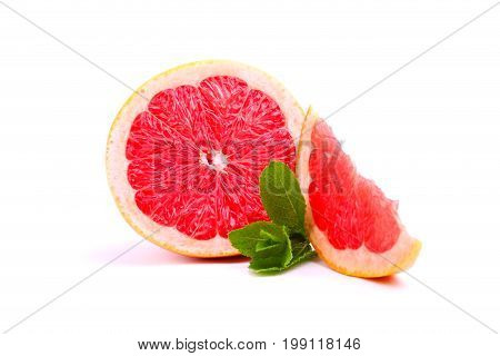 Closeup of fresh sour grapefruit with green sappy leaves of mint, refreshing fruits and herbs for making the body healthier isolated on a white background.