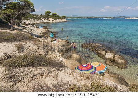 CHALKIDIKI, CENTRAL MACEDONIA, GREECE - AUGUST 26, 2014: Seascape of Karidi Beach Vourvourou at Sithonia peninsula, Chalkidiki, Central Macedonia, Greece