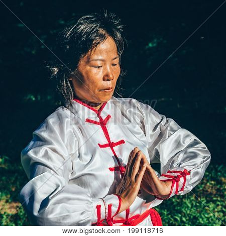 Tai Chi training in forest color image one woman only nature in background