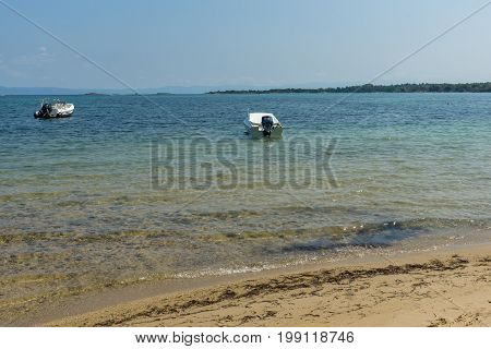 CHALKIDIKI, CENTRAL MACEDONIA, GREECE - AUGUST 26, 2014: Seascape of Beach of Vourvourou at Sithonia peninsula, Chalkidiki, Central Macedonia, Greece