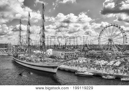 Szczecin Poland - August 06 2017: Sailing vessels and an amusement park on Lasztownia island at the Final of The Tall Ships Races 2017 in Szczecin.