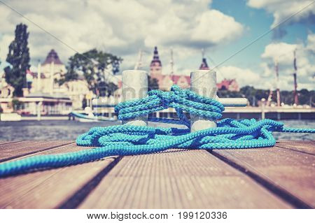 Cleat With Blue Rope On A Wooden Pier In Szczecin, Poland.