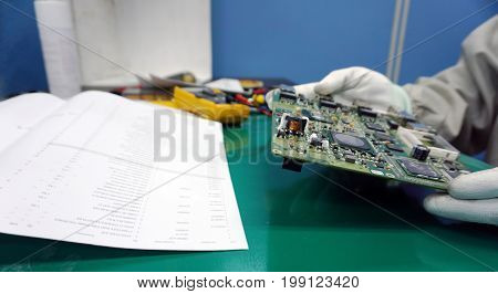 Maintenance support and repairing service concept. Electronic circuit board inspecting close up. Engineer measuring computer component