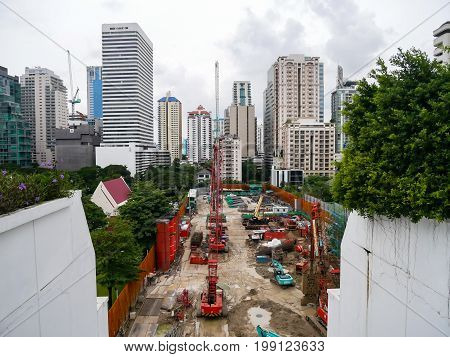 Bangkok Thailand - August 6 2017 : A Construction site of building being built during early stage surrounded by complete buildings in modern city.