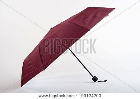 Opened Maroon Umbrella Isolated On White Background
