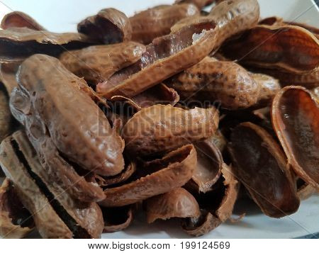 wet brown peanut shells from eating boiled peanuts