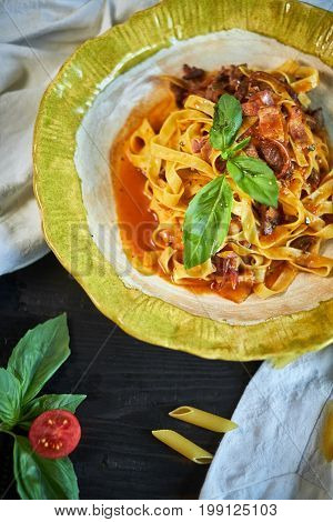 Italian penne pasta with tomatoes and pesto in a restaurant