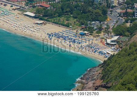 ALANYA TURKEY - JULY 09 2015: The city beach in Alanya. The view from the bird's eye view. Alanya - a popular holiday destination for European tourists.