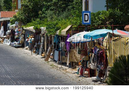 ALANYA TURKEY - JULY 09 2015: Street trade in traditional Turkish clothes souvenirs and gifts along the way. Alanya - a popular holiday destination for European tourists.