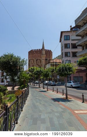 ALANYA TURKEY - JULY 09 2015: The city view in the background Red Tower (Kizil Kule). Alanya - a popular holiday destination for European tourists.