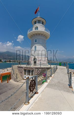 ALANYA TURKEY - JULY 09 2015: The lighthouse at the entrance to the sea port of Alanya. Alanya - a popular holiday destination for European tourists.