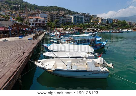 ALANYA TURKEY - JULY 09 2015: Private yachts and boats in the marina the seaport of Alanya. Alanya - a popular holiday destination for European tourists.