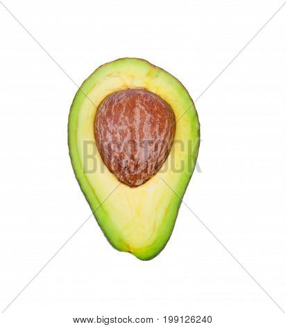 Close-up of an organic green avocado cut in half with a large brown stone, isolated on a white background. A colorful, fresh and ripe avocado for a healthy summer snack. A nutritious ingredient.