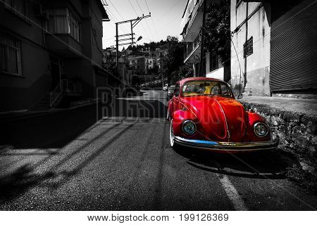 ALANYA TURKEY - JULY 09 2015: Vintage car Volkswagen Beetle on the streets of Alanya. Alanya a popular Mediterranean resort. Stylization. Toning.