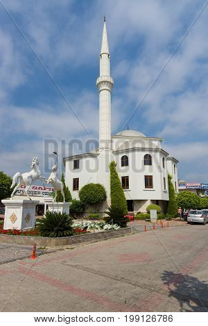 KONAKLI TURKEY - JULY 10 2015: A small mosque in the coastal village. Anatolian coast - a popular holiday destination for European tourists.