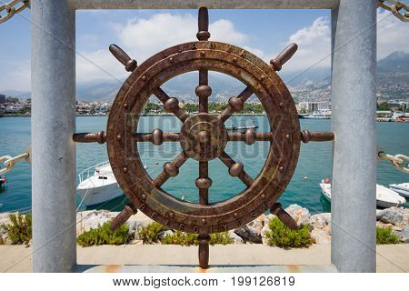 ALANYA TURKEY - JULY 09 2015: Fencing in the form of hand wheel of coastline sea port of Alanya. Alanya - a popular holiday destination for European tourists.