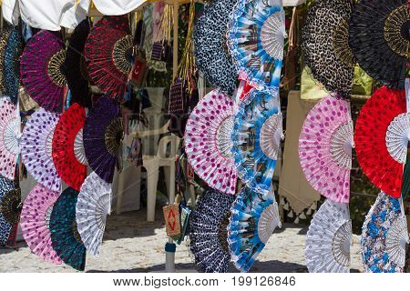 ALANYA TURKEY - JULY 09 2015: Street trade a hand-held fan. Alanya - a popular holiday destination for European tourists.
