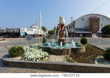 KONAKLI TURKEY - JULY 10 2015: Center of the popular tourist town of Konakli a mosque in the background. Anatolian coast - a popular holiday destination for European tourists.