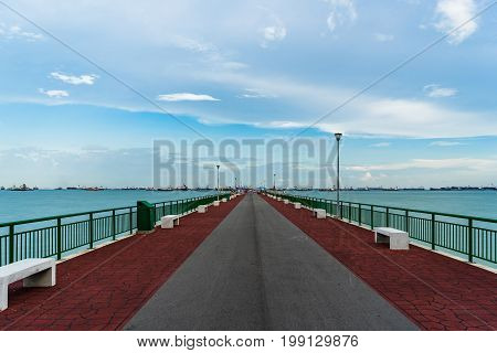 Low Angle View Of Bedok Jetty Singapore Reaching Into The Sea