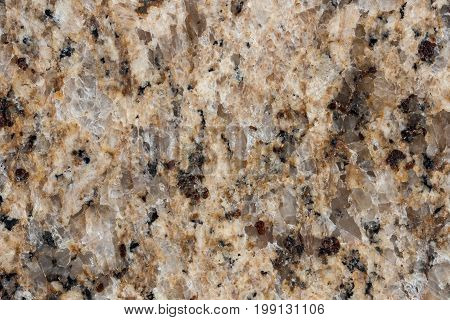 Macro closeup of beige and brown marble granite