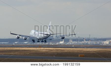 FRANKFURT, GERMANY - FEB 28th, 2015: airplane of SAUDIA AIR CARGO freighter approaching runway at Frankfurt International Airport FRA with cloudy sky in the background.