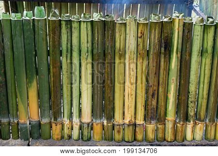 Cooking Lemang, A Type Of Bamboo Rice. Lemang Is Made Of Glutinous Rice That Is Cooked With Coconut