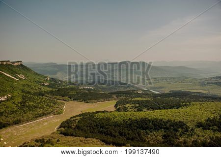 Mountains in the Crimea. The view from the top of the plateau. Sunny day. Mountain tourism.