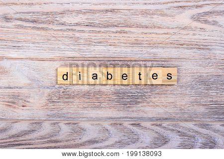 word diabetes on wooden cubes On a wooden table