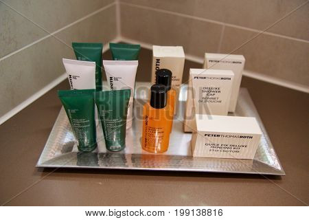 MAINZ, GERMANY - JUL 7th, 2017: Shower amenity set at a luxury hotel, A bar of soap, shampoo and body lotion.