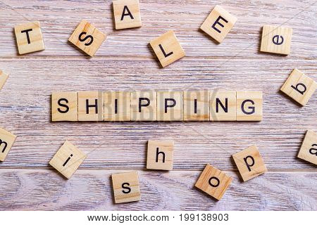 Shipping Word Written In Wooden Cube. Wooden Cube background