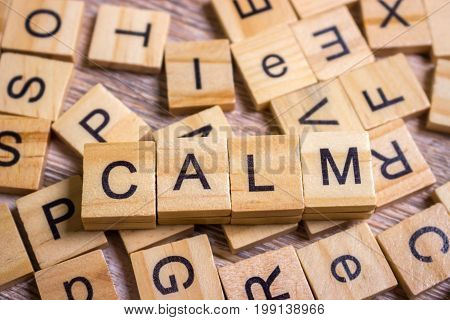 calm Word on Background of cubes with letters. Sign with wooden cubes