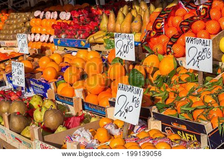 VENICE ITALY - FEB 8 2013: Various fruits from local farmers at a fruit stall in Venice.