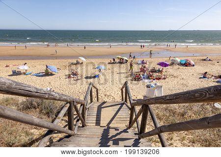 Mazagon Spain - June 4 2017: Atlantic ocean beach at the Costa de la Luz. Town of Mazagon Huelva Province Andalusia Spain