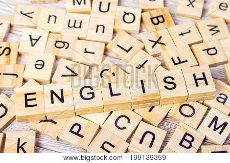 English Word Written In Wooden Cube. Wooden Cube Background