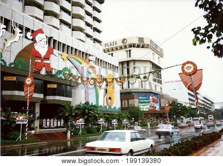 SINGAPORE - CIRCA DECEMBER, 1990: The Orchard Plaza shopping centre, on Orchard Road, is decorated for Christmas.