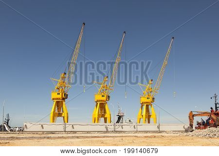 Yellow cranes in the old port of Huelva Andalusia Spain