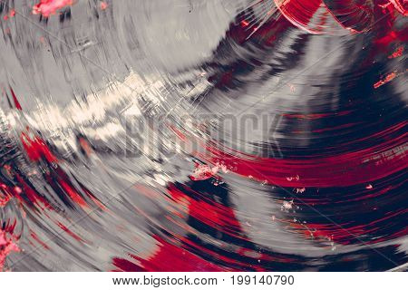 circular glass chips of gray color with splashes of bright red and pink color, broken, large texture, red chaotic stripes and spots, background image,