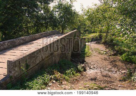 Medieval stone bridge over rio seco in Leboreiro. Camino de Santiago Galicia Spain