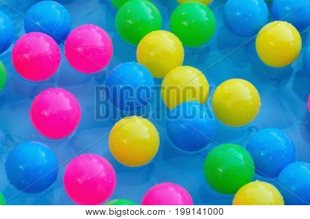 Some Plastic Balls In A Pool