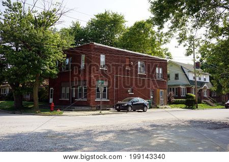 JOLIET, ILLINOIS / UNITED STATES - JULY 17, 2017: A two story brick apartment building stands at the corner of Wilcox and Douglas Streets.