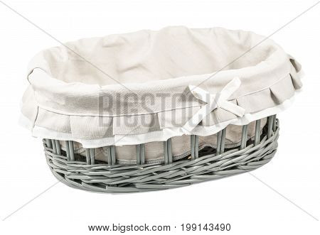 Beautiful empty wicker basket covered with decorative linen cloth isolated on white background