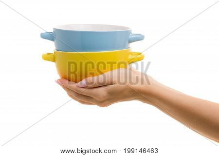Two soup plates in a female hand on a white background isolation