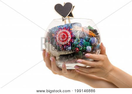 Container with bijouterie in a female hand on a white background isolation