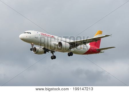 London UK - August 8 2017:Airbus A320 Iberia airlines landing at London Heathrow airport