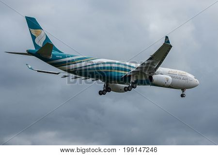 London UK - August 8 2017:Airbus A330 Oman air airlines landing at London Heathrow airport