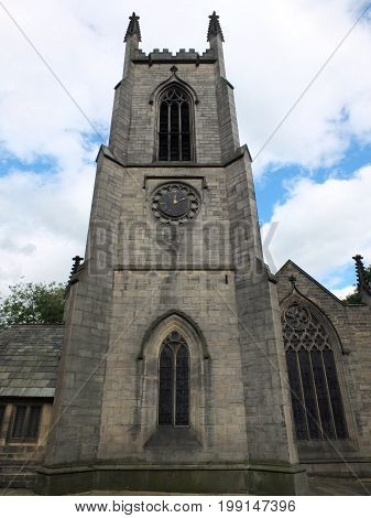 the church of saint johns in leeds a seventeenth century church showing the tower clock and windows
