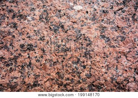Natural background from a granite stone texture.